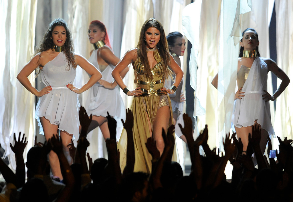 . Selena Gomez, center, performs at the Billboard Music Awards at the MGM Grand Garden Arena on Sunday, May 19, 2013 in Las Vegas. (Photo by Chris Pizzello/Invision/AP)