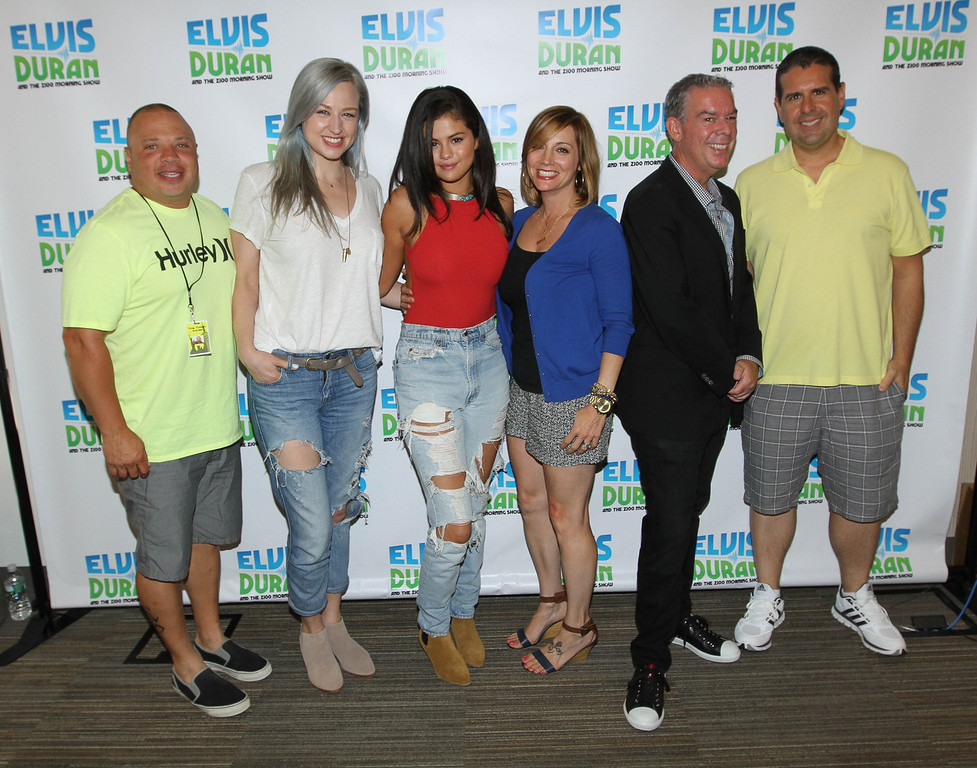 ". Selena Gomez (C) poses with the Z100 team, (L-R) Greg T, Bethany Watson, Danielle Monaro, Elvis Duran and Skeery Jones at ""The Elvis Duran Z100 Morning Show\"" at Z100 Studio on June 22, 2015 in New York City.  (Photo by Rob Kim/Getty Images for The Elvis Duran Z100 Morning Show)"