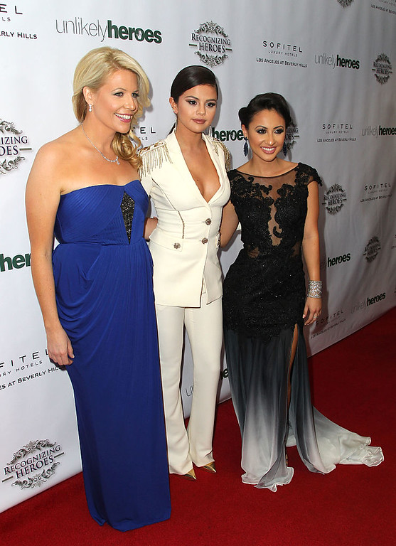 . (L-R) Erica Greve Founder of Annual Unlikely Heroes, Actress Selena Gomez and  Host Francia Raisa attend the 3rd Annual Unlikely Heroes Awards Dinner and Gala at Sofitel Hotel on November 8, 2014 in Los Angeles, California.  Gomez said in an Instagram post on Thursday, Sept. 14, that due to her struggle with lupus she received a kidney transplant donated by Raisa. (Photo by David Buchan/Getty Images)