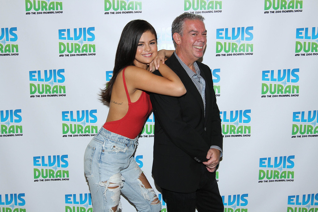 ". Selena Gomez (L) poses with host Elvis Duran at ""The Elvis Duran Z100 Morning Show\"" at Z100 Studio on June 22, 2015 in New York City.  (Photo by Rob Kim/Getty Images for The Elvis Duran Z100 Morning Show)"