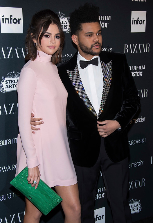 . Selena Gomez, left, and Abel Tesfaye, known professionally as The Weeknd, attend the Harper\'s BAZAAR \'Icons by Carine Roitfeld\' party at The Plaza Hotel on Friday, Sept. 8, 2017, in New York. (Photo by Charles Sykes/Invision/AP)