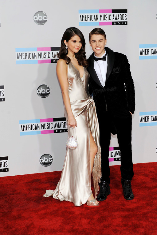 . Selena Gomez, left, and Justin Bieber arrive at the 39th Annual American Music Awards on Sunday, Nov. 20, 2011 in Los Angeles. (AP Photo/Chris Pizzello)
