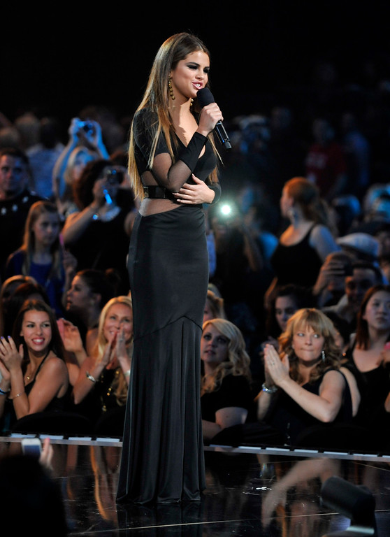 . Selena Gomez speaks on stage at the Billboard Music Awards at the MGM Grand Garden Arena on Sunday, May 19, 2013 in Las Vegas. (Photo by Chris Pizzello/Invision/AP)