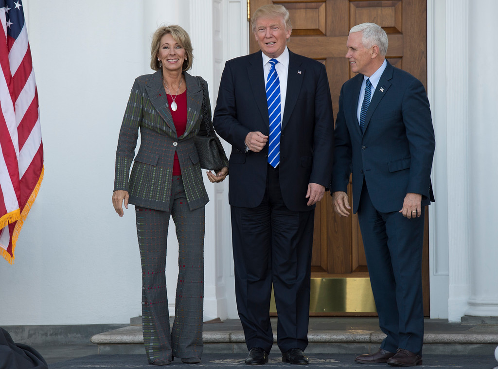 . US President-elect Donald Trump and Vice President-elect Mike Pence meet with businesswoman Betsy DeVos at Trump National Golf Club November 19, 2016 in Bedminster, New Jersey. (DON EMMERT/AFP/Getty Images)