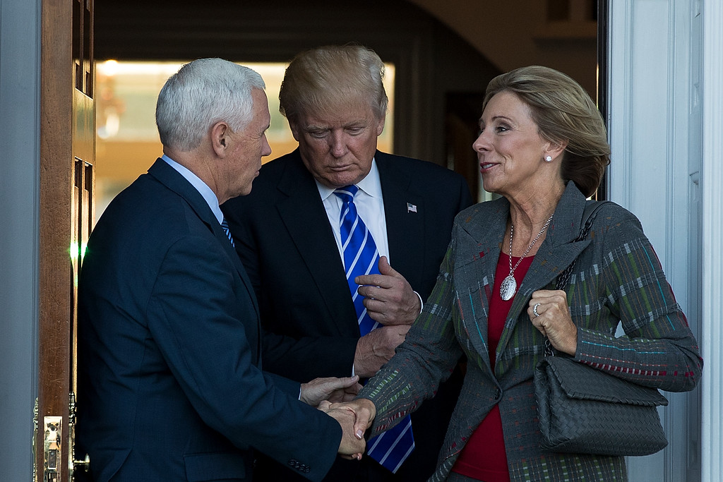 . BEDMINSTER TOWNSHIP, NJ - NOVEMBER 19: (L to R) Vice president-elect Mike Pence, president-elect Donald Trump and Betsy DeVos  leave the clubhouse after their meeting at Trump International Golf Club, November 19, 2016 in Bedminster Township, New Jersey. Trump and his transition team are in the process of filling cabinet and other high level positions for the new administration.  (Photo by Drew Angerer/Getty Images)