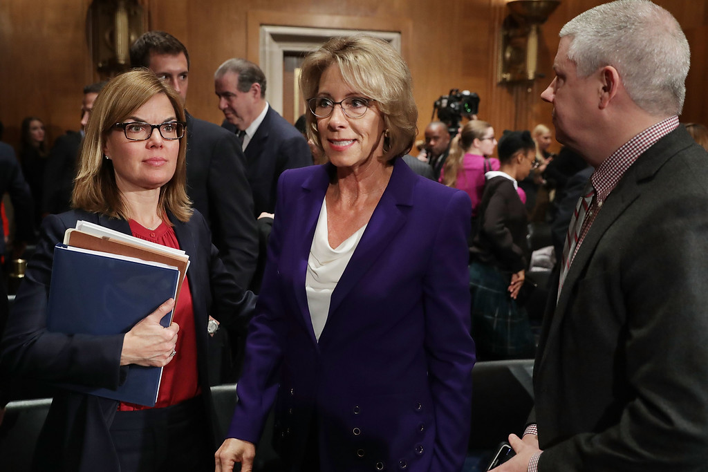 . WASHINGTON, DC - JANUARY 17:  Betsy DeVos (C), President-elect Donald Trump\'s pick to be the next Secretary of Education, leaves at the conclusion of her confirmation hearing before the Senate Health, Education, Labor and Pensions Committee in the Dirksen Senate Office Building on Capitol Hill  January 17, 2017 in Washington, DC. DeVos is known for her advocacy of school choice and education voucher programs and is a long-time leader of the Republican Party in Michigan.  (Photo by Chip Somodevilla/Getty Images)
