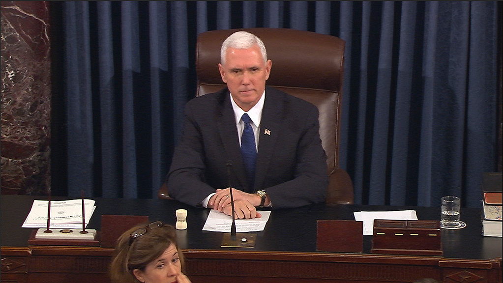 . In this image from video, provided by Senate Television shows Vice President Mike Pence presiding over the Senate on Capitol Hill in Washington, Tuesday, Feb. 7, 2017, during the Senate\'s vote on Education Secretary-designate Betsy DeVos. The Senate confirmed DeVos with Pence breaking a 50-50 tie. (Senate Television via AP)