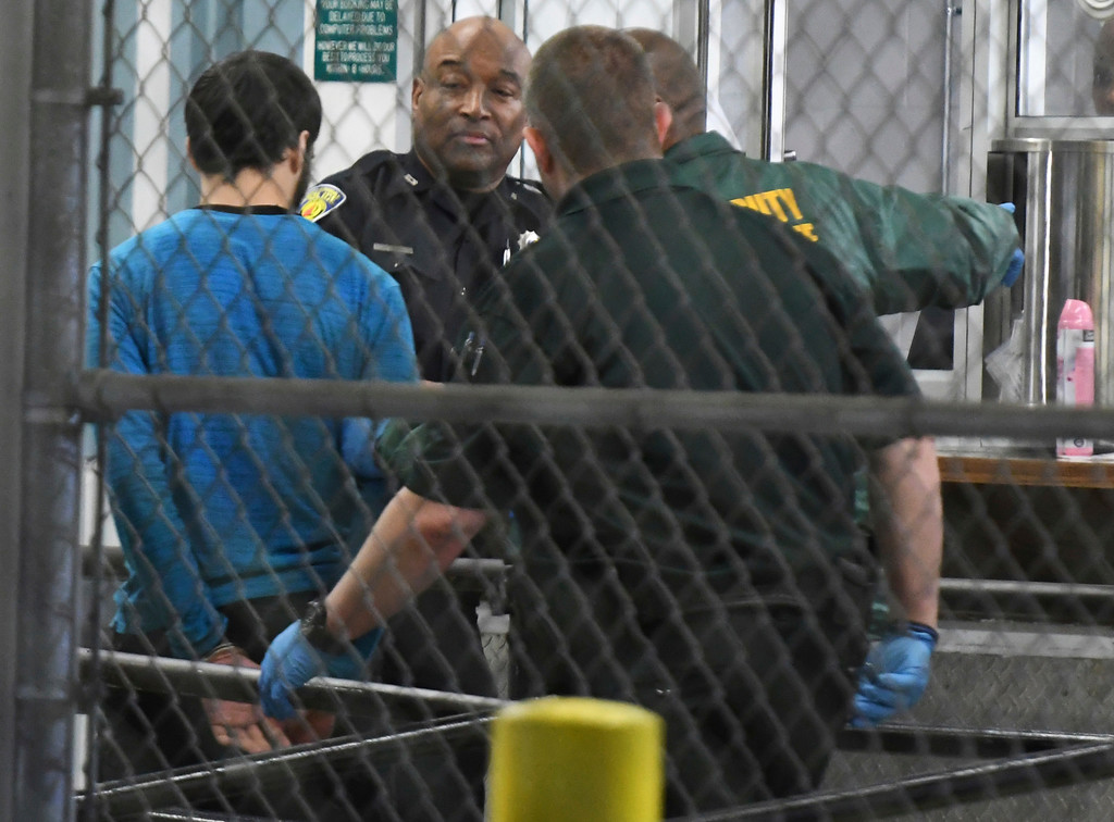 . Esteban Santiago, 26, the suspect in the deadly shooting at Fort Lauderdale-Hollywood International Airport, is transported to the Broward County Main Jail by authorities, Saturday, Jan. 7, 2017, in Fort Lauderdale, Fla. The man police say opened fire with a gun from his checked baggage leaving several people dead and wounding others at a Florida airport had a history of mental health problems � some of which followed his military service in Iraq � and was receiving psychological treatment at his home in Alaska, his relatives said Friday after the deadly shooting.  (Jim Rassol/South Florida Sun-Sentinel via AP)