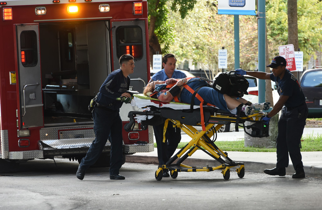 ". An injured woman is taken into Broward Health Trauma Center in Fort Lauderdale, Fla., after a shooting at the Fort Lauderdale-Hollywood International Airport on Friday, Jan. 6, 2017. Authorities say a lone shooter opened fire at the airport Friday afternoon, killing ""multiple\"" people before he was taken into custody. (Taimy Alvarez/South Florida Sun-Sentinel via AP)"
