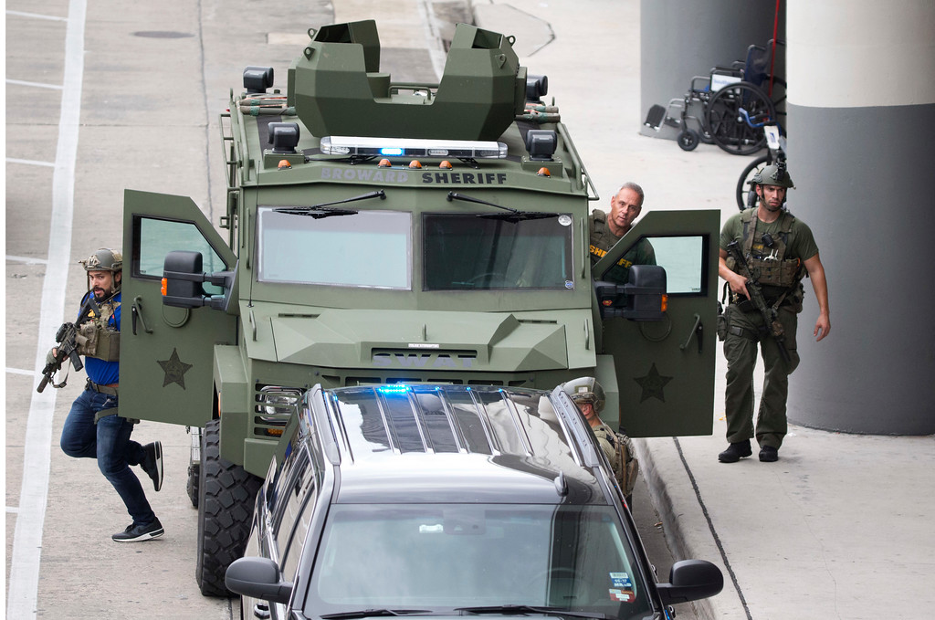 . Law enforcement personnel arrive in an armored car outside Fort Lauderdale�Hollywood International Airport, Friday, Jan. 6, 2017, in Fort Lauderdale, Fla. A gunman opened fire in the baggage claim area at the airport Friday, killing several people and wounding others before being taken into custody in an attack that sent panicked passengers running out of the terminal and onto the tarmac, authorities said. (AP Photo/Wilfredo Lee)