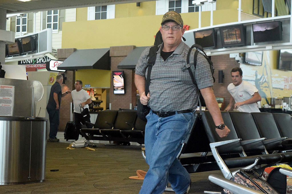 . Passengers run for cover in Terminal 1 at Fort Lauderdale�Hollywood International Airport, Friday, Jan. 6, 2017, in Fort Lauderdale, Fla. An Army veteran who complained that the government was controlling his mind drew a gun from his checked luggage on arrival at the Fort Lauderdale airport and opened fire in the baggage claim area Friday, killing several people and wounding others, authorities said. (Paul E. Kostyu via AP)