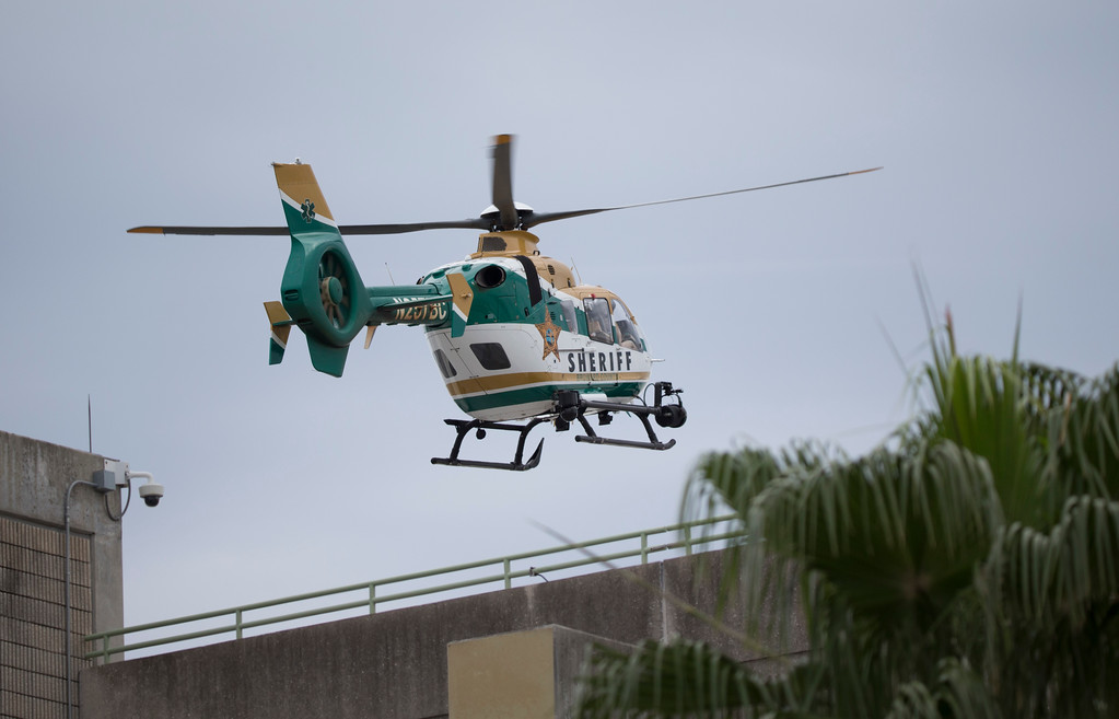 . Law enforcement helicopter flies over a garage area at Fort Lauderdale�Hollywood International Airport, Friday, Jan. 6, 2017, in Fort Lauderdale, Fla., after a shooter opened fire inside a terminal of the airport, killing several people and wounding others before being taken into custody. (AP Photo/Wilfredo Lee)