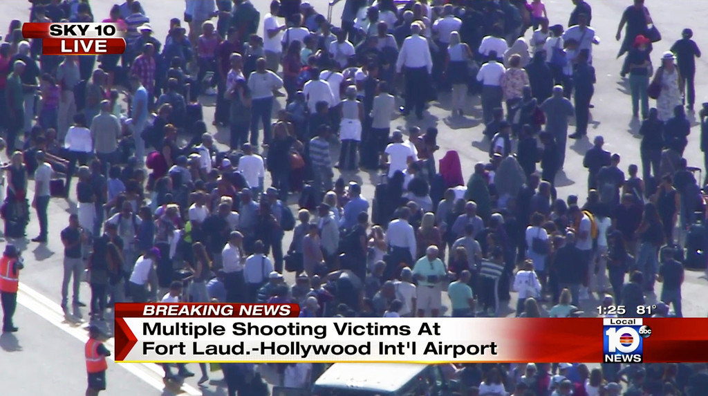 . In this still image from video provided by NBC TV Local10, people stand on the tarmac after shots were fired at the international airport in Fort Lauderdale, Fla., Friday, Jan. 6, 2017. Local10 and other news media outlets reported Friday that multiple people were shot. (NBC TV Local10 via AP)