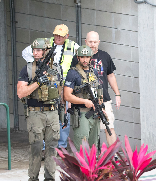 . Law enforcement personnel are shown outside a garage area at Fort Lauderdale�Hollywood International Airport, Friday, Jan. 6, 2017, in Fort Lauderdale, Fla., after a shooter opened fire inside a terminal of the airport, killing several people and wounding others before being taken into custody.  (AP Photo/Wilfredo Lee)