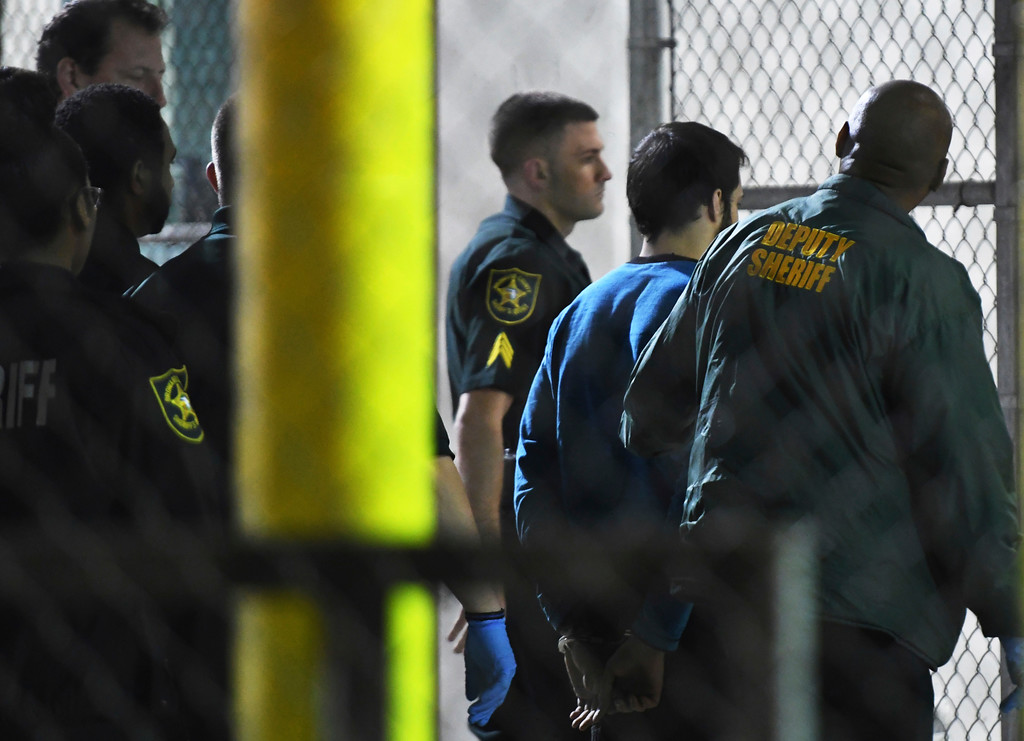 . Esteban Santiago, 26, the suspect in the deadly shooting at Fort Lauderdale-Hollywood International Airport, is transported to the Broward County Main Jail by authorities, Saturday, Jan. 7, 2017. The gunman who fatally shot several people and wounded others on Friday in Fort Lauderdale\'s airport sent panicked passengers running out of the terminal and onto the tarmac with bags in hand.  (Jim Rassol/South Florida Sun-Sentinel via AP)