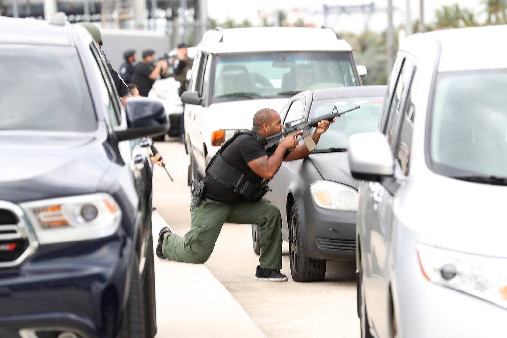 . FORT LAUDERDALE, FL - JANUARY 06: First responders secure the area outside the Fort Lauderdale-Hollywood International airport after a shooting took place near the baggage claim on January 6, 2017 in Fort Lauderdale, Florida. Officials are reporting that five people wear killed and eight wounded in an attack by a single gunman.   (Photo by Joe Raedle/Getty Images)