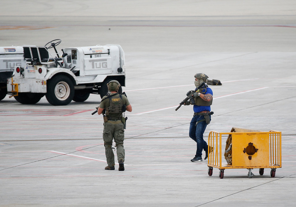 . Law enforcement officers are shown at Fort Lauderdale�Hollywood International Airport, Friday, Jan. 6, 2017, in Fort Lauderdale, Fla.  A gunman opened fire in the baggage claim area at the airport Friday, killing several people and wounding others before being taken into custody in an attack that sent panicked passengers running out of the terminal and onto the tarmac, authorities said. (AP Photo/Wilfredo Lee)