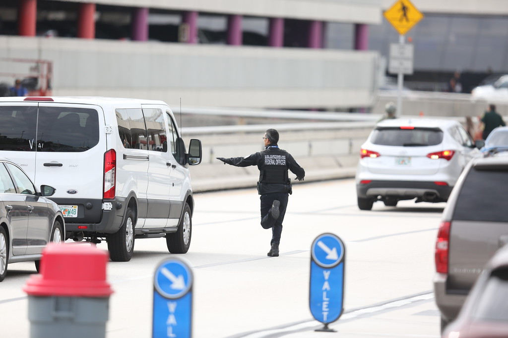 . FORT LAUDERDALE, FL - JANUARY 06:  First responders secure the area outside the Fort Lauderdale-Hollywood International airport after a shooting took place near the baggage claim on January 6, 2017 in Fort Lauderdale, Florida. Officials are reporting that five people wear killed and eight wounded in an attack from a single gunman.   (Photo by Joe Raedle/Getty Images)