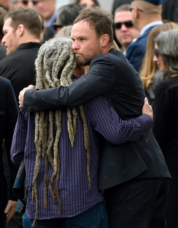 . Jeff Ament, of Pearl Jam, hugs a guest at a funeral for Chris Cornell at the Hollywood Forever Cemetery on Friday, May 26, 2017, in Los Angeles. (Photo by Chris Pizzello/Invision/AP)