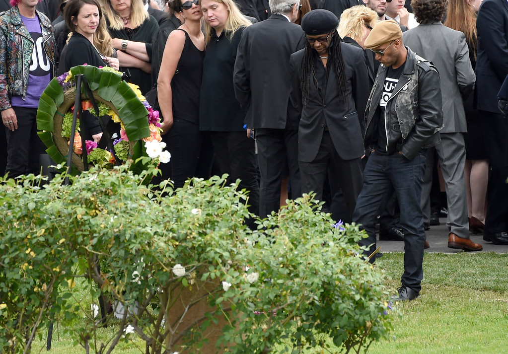 . Tom Morello, from right, and Nile Rodgers attend a funeral for Chris Cornell at the Hollywood Forever Cemetery on Friday, May 26, 2017, in Los Angeles. (Photo by Chris Pizzello/Invision/AP)