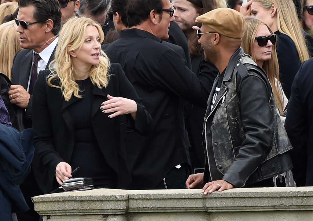 . Courtney Love, left, and Tom Morello attend a funeral for Chris Cornell at the Hollywood Forever Cemetery on Friday, May 26, 2017, in Los Angeles. (Photo by Chris Pizzello/Invision/AP)