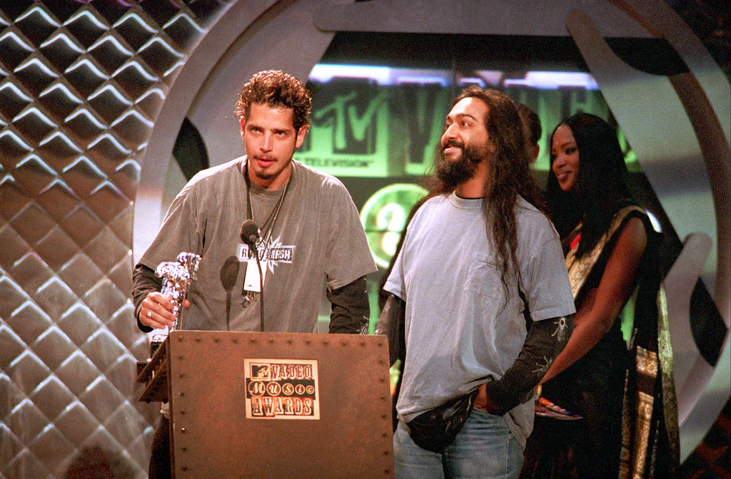 """. Chris Cornell, left, and Kim Thayil of Soundgarden accept their award at the MTV Video Music Awards at New York\'s Radio City Music Hall, Thursday night, Sept. 8, 1994.  The band won Best Metal/Hard Rock Video for \""""Black Hole Sun.\""""  At far right is British fashion model Naomi Campbell, who presented the award.  (AP Photo/Bebeto Matthews)"""