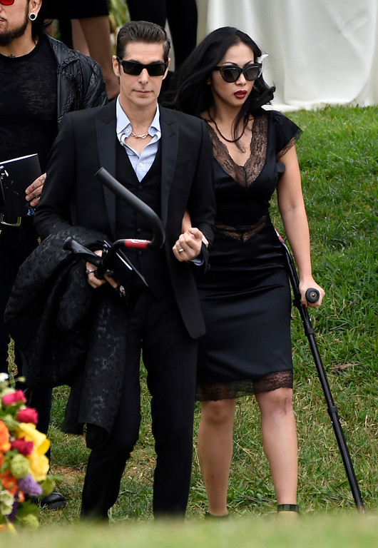 . Perry Farrell, left, and Etty Lau Farrell attend a funeral for Chris Cornell at the Hollywood Forever Cemetery on Friday, May 26, 2017, in Los Angeles. (Photo by Chris Pizzello/Invision/AP)