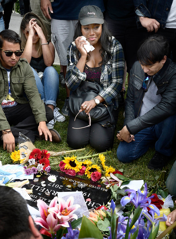 . Victoria Ebiana wipes away her tears. The public was allowed to pay respects at the grave site after a memorial service was held at Hollywood Forever Cemetary for Chris Cornell, the iconic rocker who hanged himself in a Detroit hotel room earlier this month. Los Angeles, CA. 5/26/2017 Photo by John McCoy/Los Angeles Daily News (SCNG)
