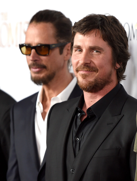""". Chris Cornell, left, and Christian Bale arrive at the U.S. premiere of \""""The Promise\"""" at the TCL Chinese Theatre on Wednesday, April 12, 2017, in Los Angeles. (Photo by Chris Pizzello/Invision/AP)"""