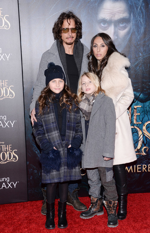 """. Chris Cornell poses with his wife Vicky and their children at the premiere of \""""Into The Woods\"""" at the Ziegfeld Theatre on Monday, Dec. 8, 2014, in New York. (Photo by Evan Agostini/Invision/AP)"""