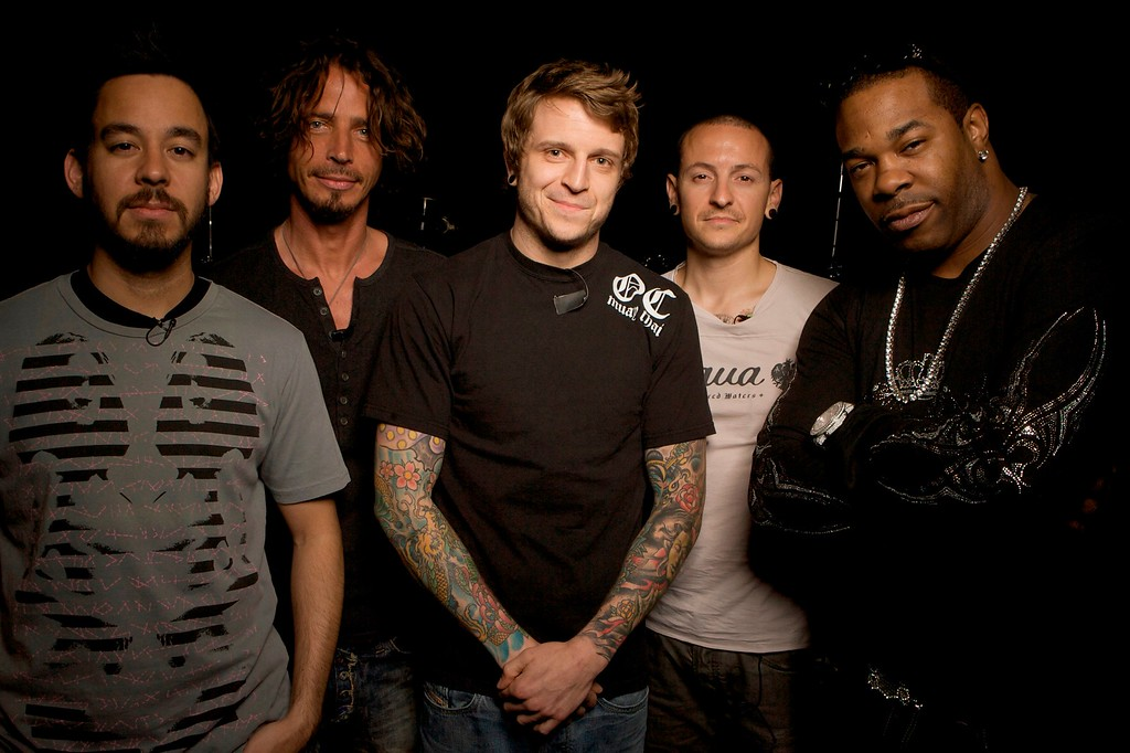 . Musicians left to right: Linkin Park co-lead vocalist Mike Shinoda, former Soundgarden/Audioslave vocalist Chris Cornell, Linkin Park co-lead vocalist Chester Bennington, Atreyu vocalist Alex Varkatzas and Jamaican American hip hop musician and actor Busta Rhymes pose for a photo at the Linkin Park band rehearsal studio Thursday, May 29, 2008 in Los Angeles. (AP Photo/Damian Dovarganes)