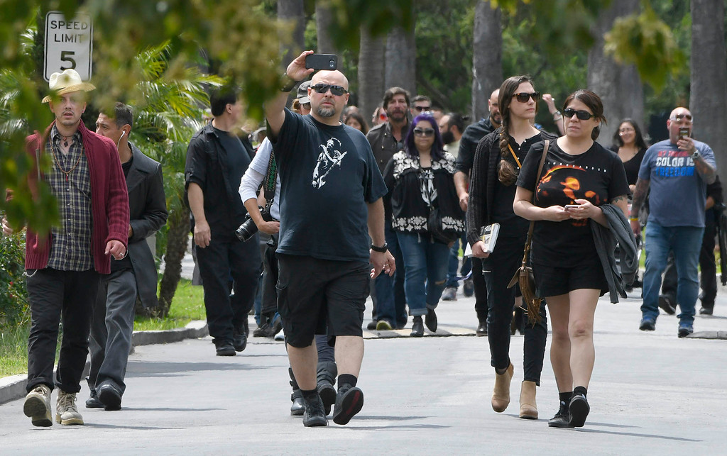 . Fans walk into the cemetary at 3 PM when the public was allowed to pay respects at the grave site for Chris Cornell.  A memorial service was held at Hollywood Forever Cemetary for Cornell, the iconic rocker who hanged himself in a Detroit hotel room earlier this month. Los Angeles, CA. 5/26/2017 Photo by John McCoy/Los Angeles Daily News (SCNG)