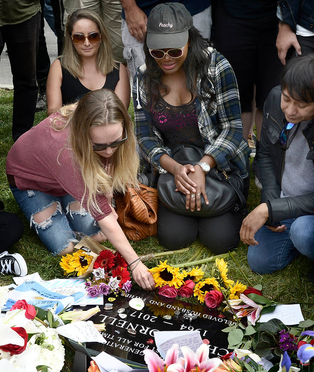 . Fans place flowers and items on the grave. The public was allowed to pay respects after a memorial service was held at Hollywood Forever Cemetary for Chris Cornell, the iconic rocker who hanged himself in a Detroit hotel room earlier this month. Los Angeles, CA. 5/26/2017 Photo by John McCoy/Los Angeles Daily News (SCNG)