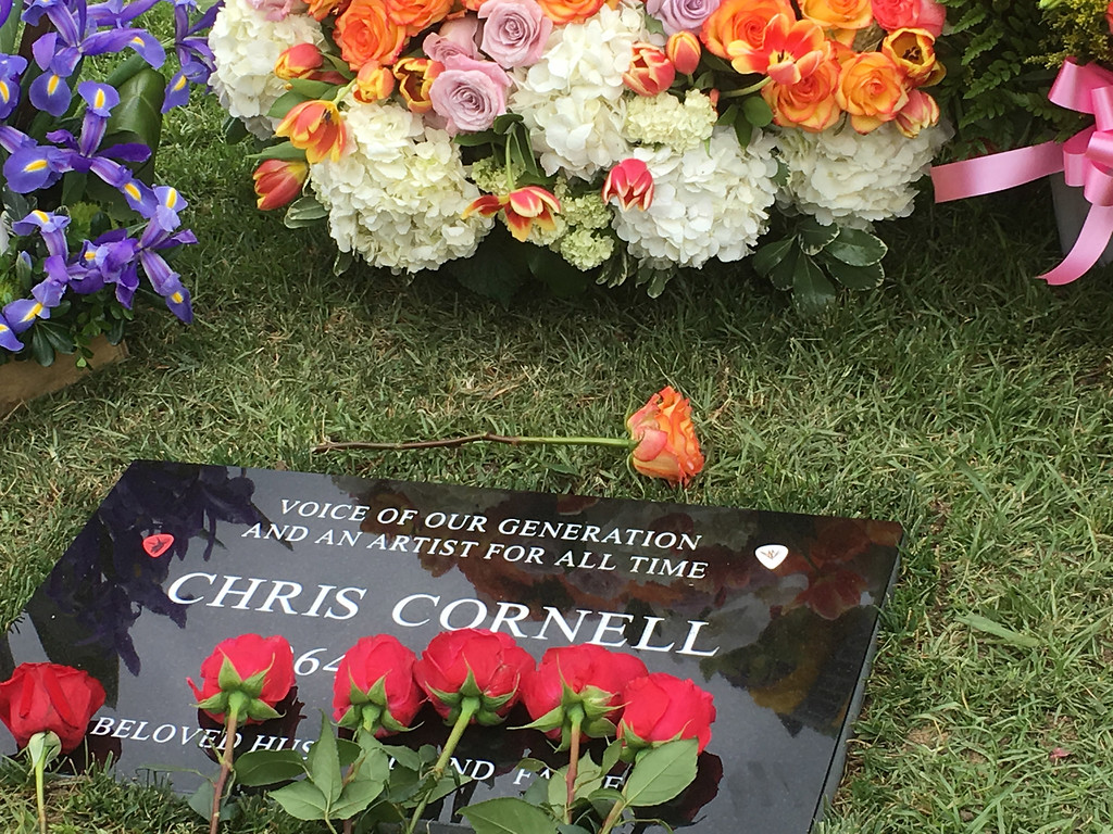 . Flowers adorn the grave marker for musician Chris Cornell at the Hollywood Forever Cemetery on Friday, May 26, 2017, in Los Angeles.  Cornell, 52, who gained fame as the lead singer of the bands Soundgarden and Audioslave, died at a hotel in Detroit last week. (AP Photo/Sandy Cohen)
