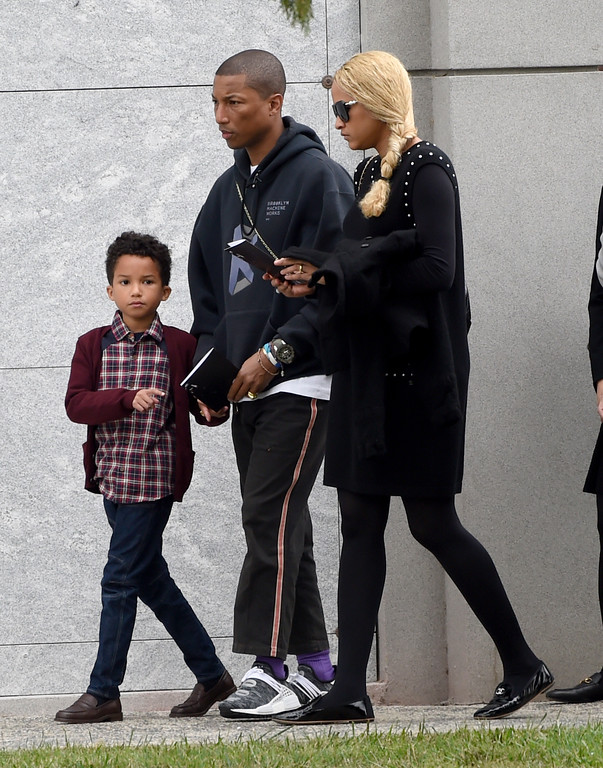 . Pharrell Williams, center, Helen Lasichanh, right, and Rocket Ayer Williams attend a funeral for Chris Cornell at the Hollywood Forever Cemetery on Friday, May 26, 2017, in Los Angeles. (Photo by Chris Pizzello/Invision/AP)