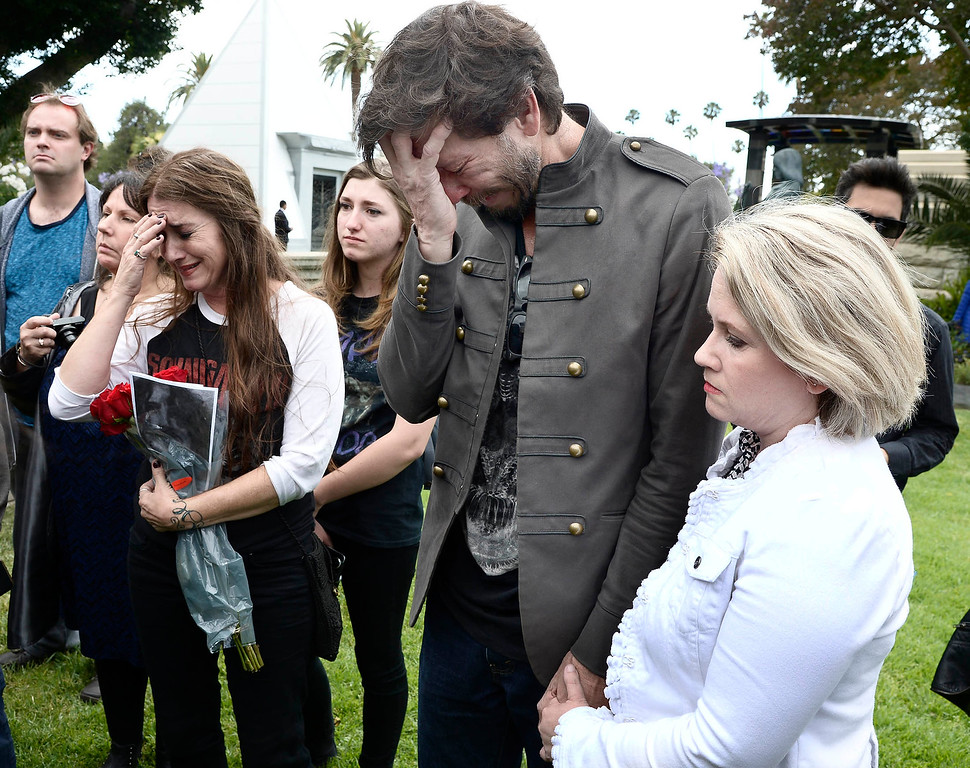 . Marcus DuBray and his fiance Kathryn Hill were among the public was allowed to pay respects at the grave site For Chris Cornell.  A memorial service was held at Hollywood Forever Cemetary for Cornell, the iconic rocker who hanged himself in a Detroit hotel room earlier this month. Los Angeles, CA. 5/26/2017 Photo by John McCoy/Los Angeles Daily News (SCNG)