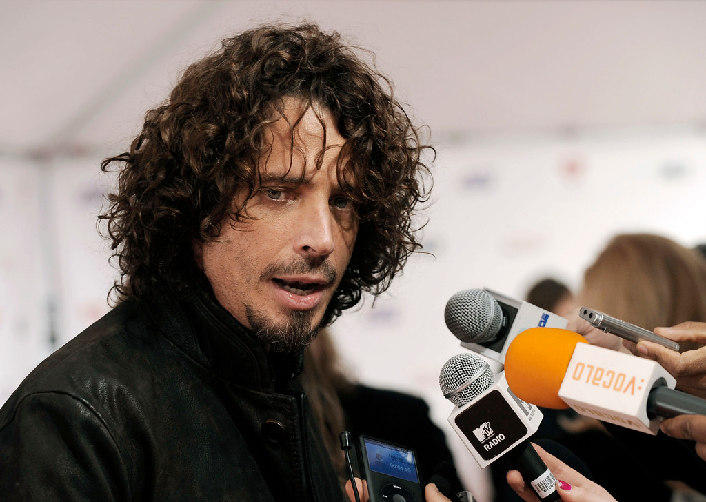 . FILE - In this Friday, Feb. 6, 2009, file photo, musician Chris Cornell speaks to the media as he arrives at the MusiCares Person of the Year tribute honoring Neil Diamond in Los Angeles. According to his representative, rocker Chris Cornell, who gained fame as the lead singer of Soundgarden and later Audioslave, has died Wednesday night in Detroit at age 52. (AP Photo/Chris Pizzello, File)