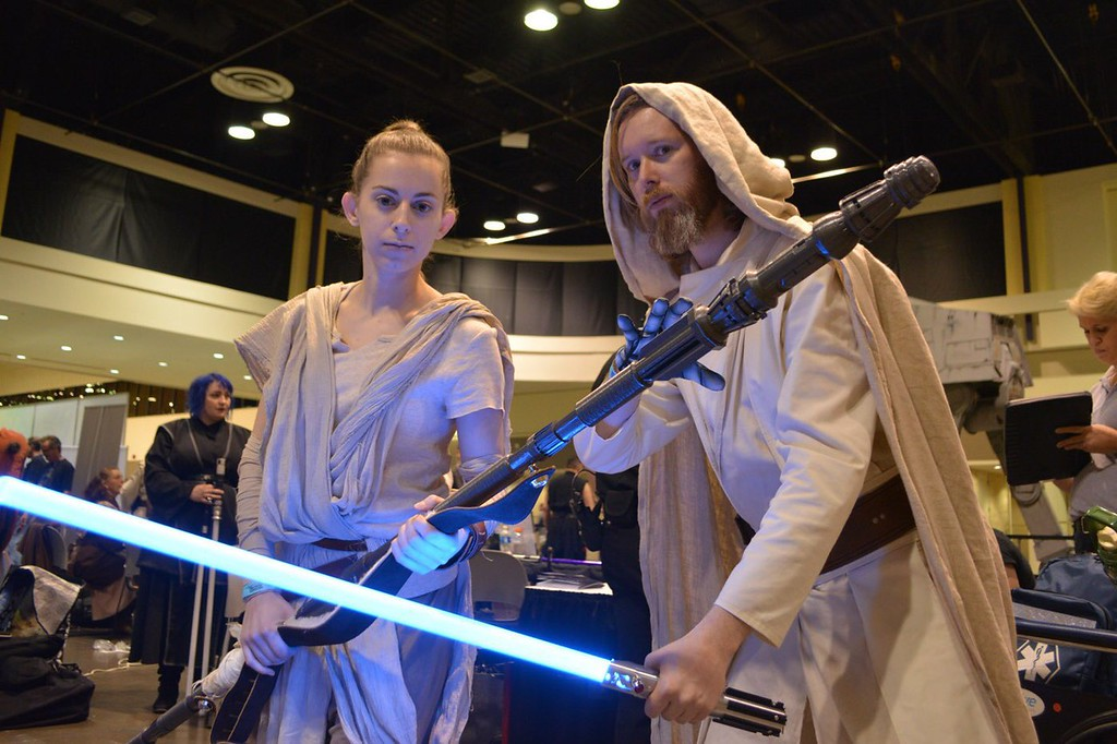 ". Cos-players and hardcore Star Wars fans Steven and Veronica Underhill, of Lindbrook, New York, play Rey and Luke Skywalker in ""The Force Awakens\"" at Star Wars Celebration Orlando. (Photo by Neil Nisperos, SCNG)"