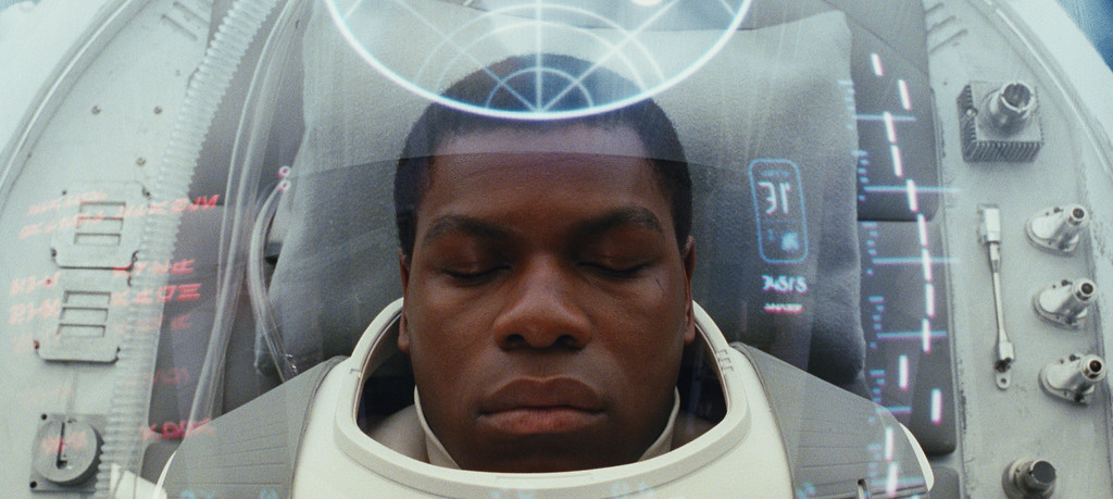 """. This image released by Lucasfilm shows John Boyega as Finn in a scene from the upcoming \""""Star Wars: The Last Jedi,\"""" expected in theaters in December.  (Industrial Light & Magic/Lucasfilm via AP)"""