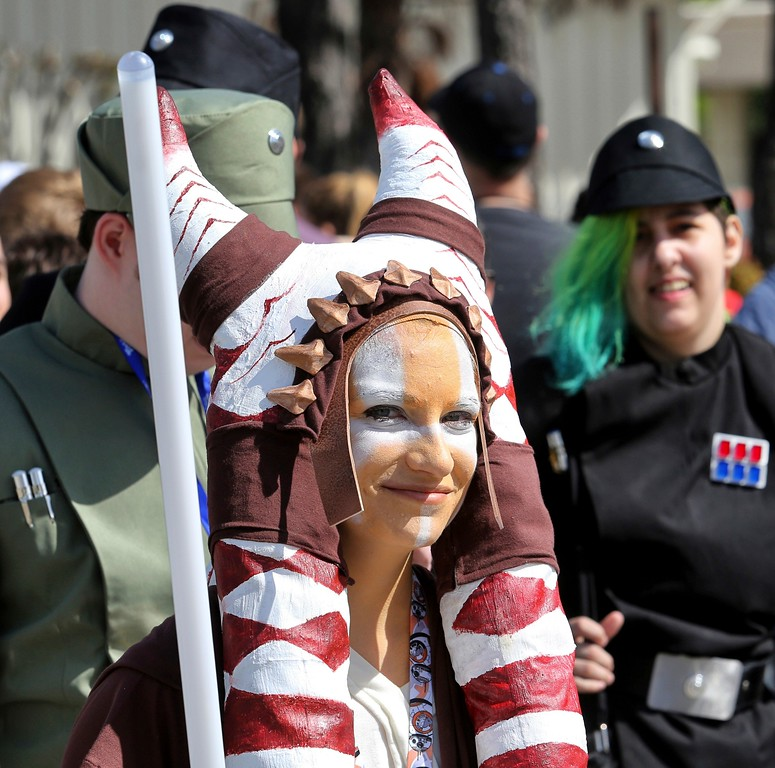 . Costumed fans of the Star Wars franchise wait in a massive line outside the Orange County Center, in Orlando, Fla., to attend the 2017 Star Wars Celebration, Thursday, April 13, 2017, marking the 40th anniversary of the original 1977 Star Wars film. Thousands of fans waited for hours in the line, estimated to be more than a mile long. (Joe Burbank/Orlando Sentinel via AP)