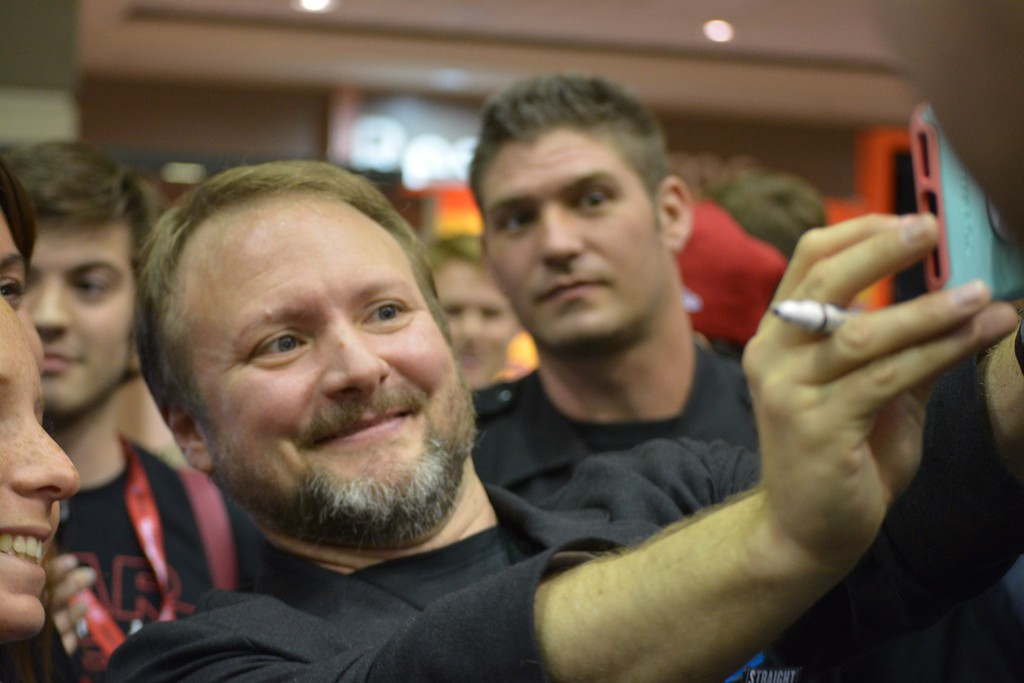 """. \""""The Last Jedi\"""" director Rian Johnson takes selfies with fans at Star Wars Celebration Orlando on Thursday. (Photo by Neil Nisperos, SCNG)"""