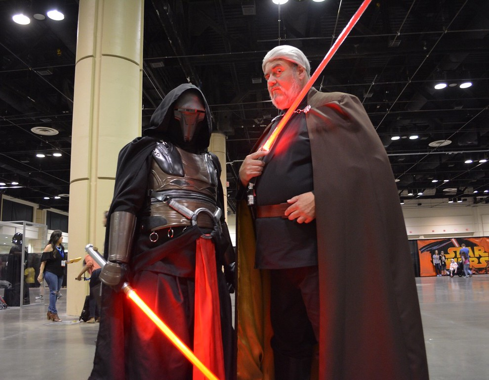 . From left, Riverside residents Ronnie Gluskoter and his father Ron Gluskoter, who are part of the Star Wars lightsaber fight reenactment group Sabre Guild, demonstrated their skills at Star Wars Celebration Orlando. (Photo by Neil Nisperos, SCNG)