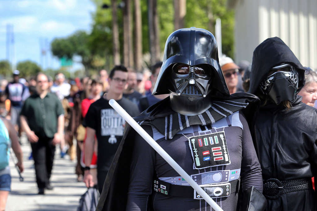". Costumed fans of the ""Star Wars\"" franchise wait in line outside the Orange County Center, in Orlando, Fla., to attend the 2017 Star Wars Celebration, Thursday, April 13, 2017, marking the 40th anniversary of the original 1977 Star Wars film. Thousands of fans waited for hours in the line, estimated to be more than a mile long.  (Joe Burbank/Orlando Sentinel via AP)"