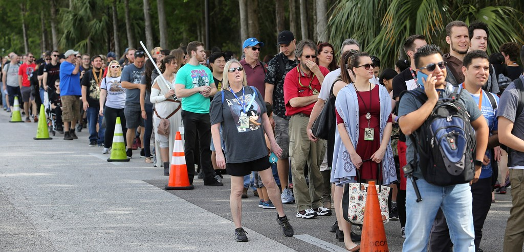 . Fans of the Star Wars franchise of movies wait in a massive line outside the Orange County Center, in Orlando, Fla., to attend the 2017 Star Wars Celebration, Thursday, April 13, 2017, marking the 40th anniversary of the original 1977 Star Wars film. Thousands of fans waited for hours in the line, estimated to be more than a mile long, to access the convention. (Joe Burbank/Orlando Sentinel via AP)