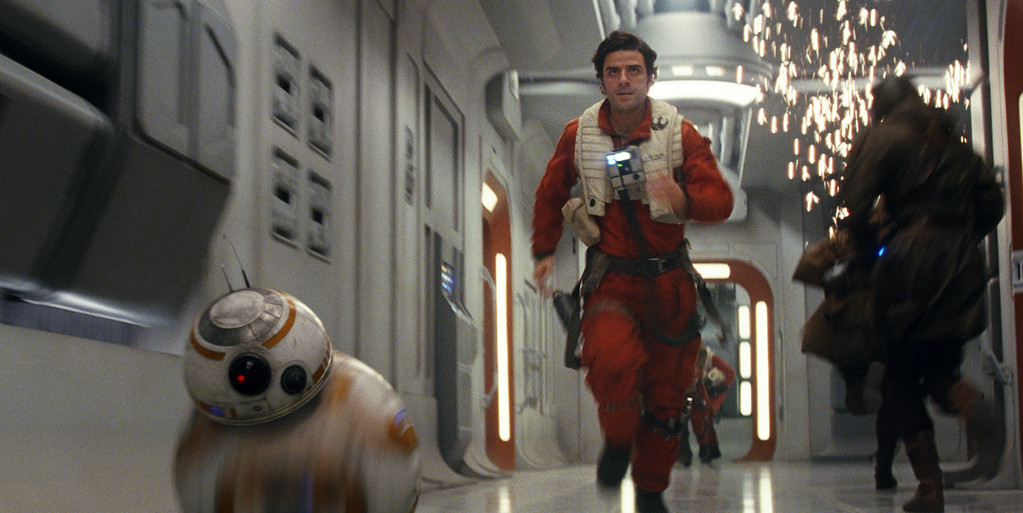 """. This image released by Lucasfilm shows Oscar Isaac as Poe Dameron in a scene from the upcoming \""""Star Wars: The Last Jedi,\"""" expected in theaters in December.  (Industrial Light & Magic/Lucasfilm via AP)"""