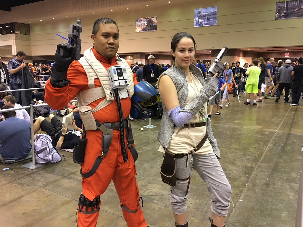 """. Cos-players Katie Sines and Kirk Malicdem, of Baltimore, Maryland, play Rey and Poe Dameron from \""""The Force Awakens\"""" at Star Wars Celebration Orlando. (Photo by Neil Nisperos, SCNG)"""