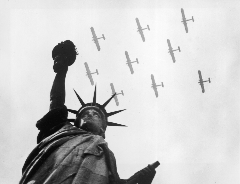 . circa 1935:  Military aircraft fly over the Statue of Liberty, New York.  (Photo by General Photographic Agency/Getty Images)