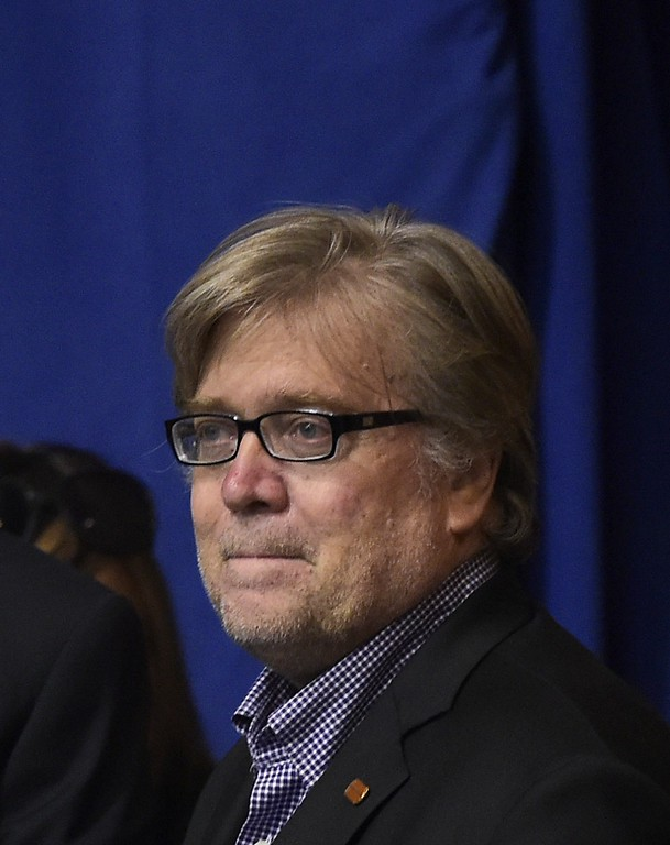. Donald Trump\'s campaign Chief Executive Officer Stephen Bannon watches as Republican presidential nominee Donald Trump speaks during a rally at the Canton Memorial Civic Center on September 14, 2016 in Canton, Ohio. (MANDEL NGAN/AFP/Getty Images)