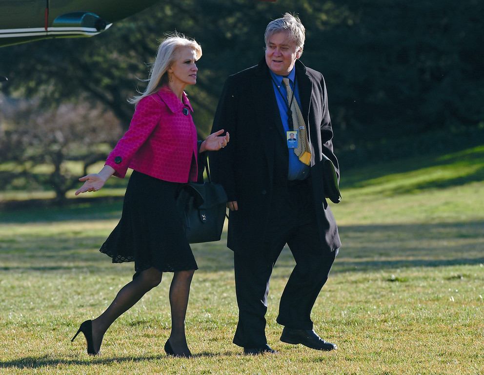 . In this Jan. 26, 2017, photo White House counselor Kellyanne Conway, left, and senior adviser Steve Bannon, right, walk on the South Lawn of the White House in Washington, after returning via Marine One from a trip to Philadelphia with President Donald Trump. Since taking office 10 days ago, President Donald Trump has moved to consolidate power within a small cadre of close aides at the White House. He�s added a senior political adviser to the National Security Council and appears to have cut out Cabinet secretaries from decision making on some of his top policies, including the immigration and refugee order that led to protests, legal challenges and temporary detention of some legal U.S. residents this weekend. (AP Photo/Susan Walsh)