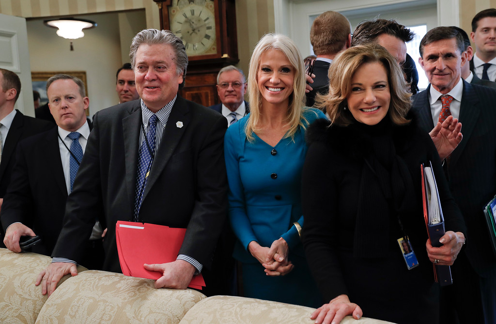 . From left, White House Press Secretary Sean Spicer, White House chief strategist Steve Bannon, Kellyanne Conway, senior adviser to President Trump, Deputy National Security Adviser K.T. McFarland and National Security Adviser Michael Flynn in the Oval Office of the White House in Washington, Thursday, Feb. 9, 2017, after watching the swearing in ceremony of Attorney General Jeff Sessions. (AP Photo/Pablo Martinez Monsivais)
